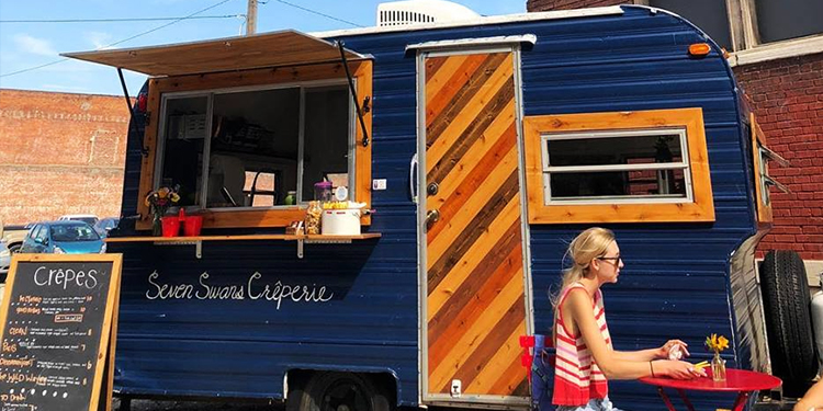 Navy Seven Swans Crêperie camper outside E 31st and Gilham.